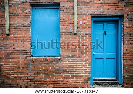 Blue door and windows, brick building, Treme, New Orleans, USA