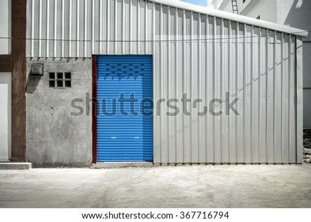 Blue door and zinc