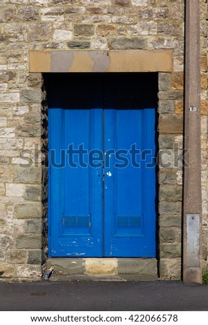 Blue door in an old stone wall