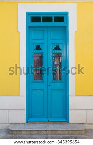 Blue door with yellow wall