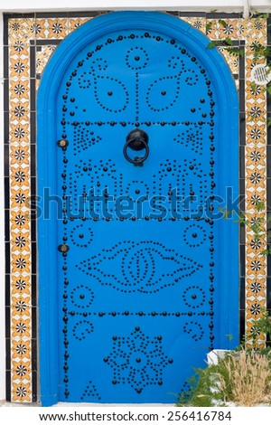 Blue doors and white wall of building in Sidi Bou Said, Tunisia - stock photo