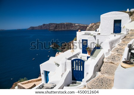 Blue doors in Oia village at suny day on Santorini island, Greece.
