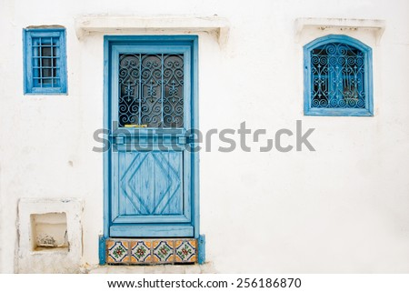 Blue doors, window and white wall of building in Sidi Bou Said, Tunisia - stock photo