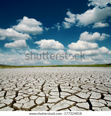 blue dramatic sky with clouds over desert - stock photo