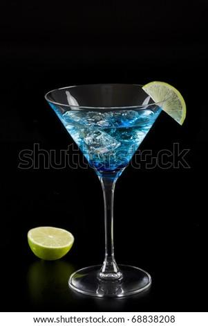 Blue drink isolated on black with lemon slice - stock photo