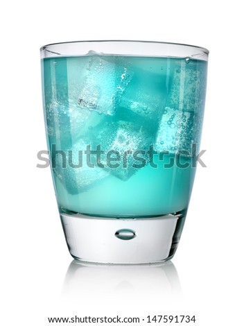 Blue drink with ice cubes in a glass isolated on a white background - stock photo