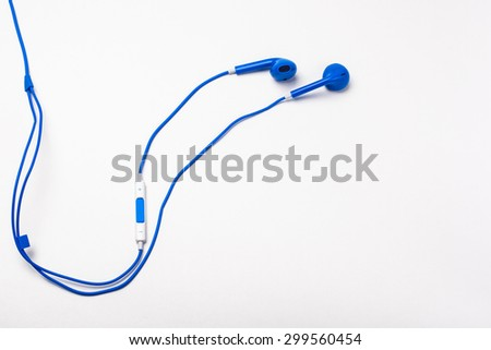 Blue earphones isolated on white background - stock photo