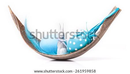 Blue easter decoration on palm leaf - stock photo