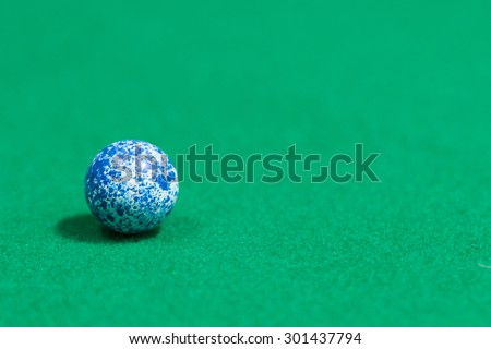 Blue Egg Like Colorful Marble Balls on Green background - stock photo
