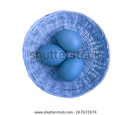 Blue eggs in basket from top view - stock photo