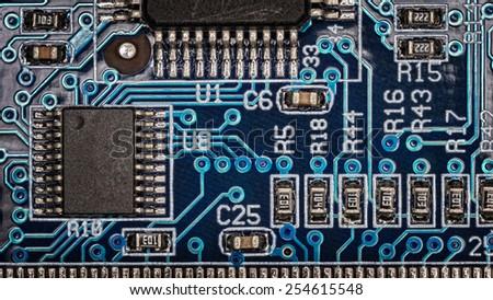 blue electronic circuit close-up - stock photo