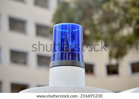 Blue emergency siren. Alarm and danger concept - stock photo