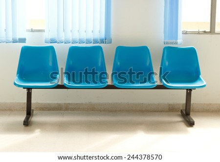 Blue empty chairs on waiting room.
