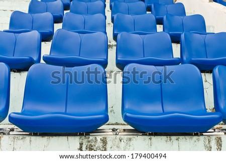 Blue empty plastic seats at stadium  - stock photo