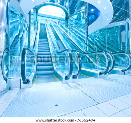 blue escalator inside business hall