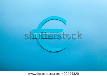 Blue euro symbol on a blue background with a soft light