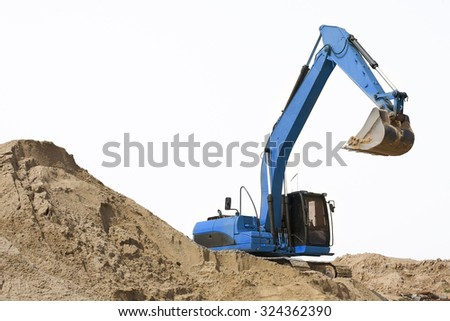 Blue excavator and the sand on white background - stock photo