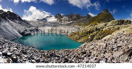 Blue eye - Lake in Switzerland - Wildsee - stock photo