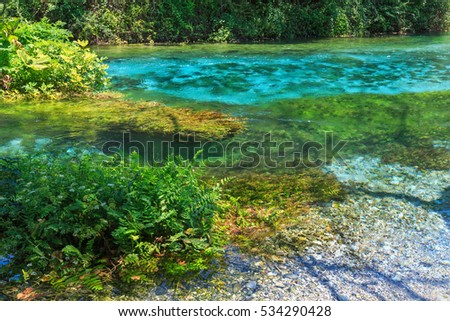 Blue Eye (water spring) with clear blue water summer view (near Muzine in Vlore County, Albania).