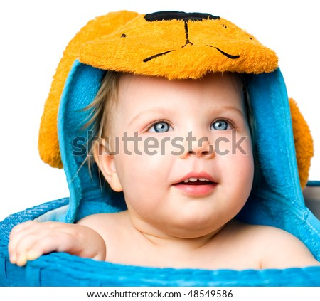 blue-eyed kid in a blue basket, isolated on white