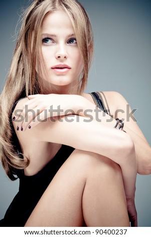 blue eyes blond  woman portrait, studio shot - stock photo