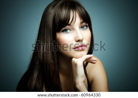 blue eyes brunette beauty portrait studio shot - stock photo