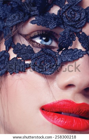 Blue eyes closeup.Beautiful fashion girl with arrow make up. Closeup female eye with beautiful fashion bright makeup,lace on the face - stock photo