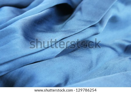Blue fabric as a background. - stock photo