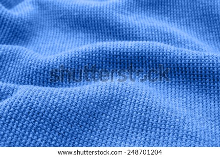 Blue fabric as the background. - stock photo