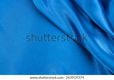 Blue fabric background. - stock photo