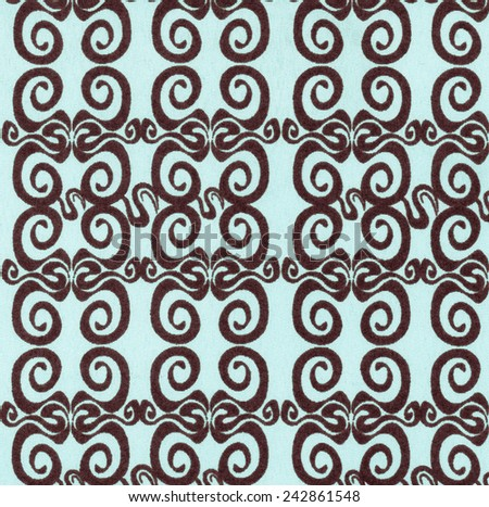 Blue Fabric background with Brown Pattern Swirls - stock photo