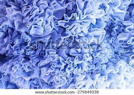 Blue fabric flounces background  - stock photo