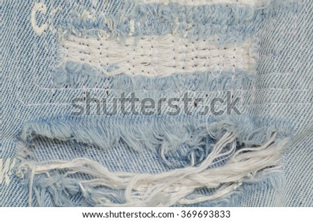 blue faded ripped jeans, close up