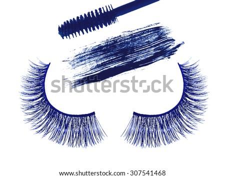 Blue false eyelash and stroke (sample) of blue mascara isolated on white background - stock photo