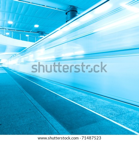 blue fast moving train