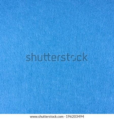 Blue felt cloth fragment as a background texture - stock photo