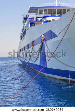 Blue ferryboat for the transport of people and cars