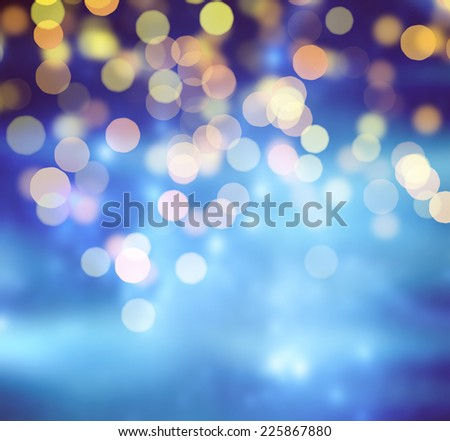 Blue Festive Christmas background. Abstract background with bokeh defocused lights and stars - stock photo