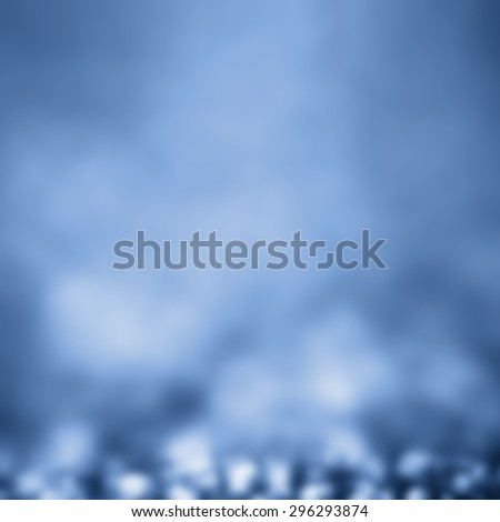Blue Festive Christmas elegant abstract background with bokeh light. Defocused white and blue  lights.