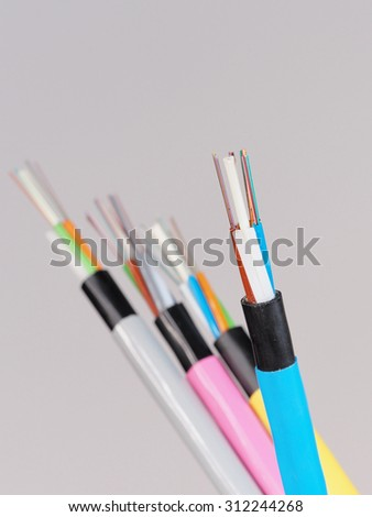 Blue fiber optic cable with stripped and  exposed fibers in front of other cables, Melbourne 2015     - stock photo