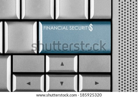 Blue FINANCIAL SECURITY key on a computer keyboard with clipping path around the FINANCIAL SECURITY key - stock photo