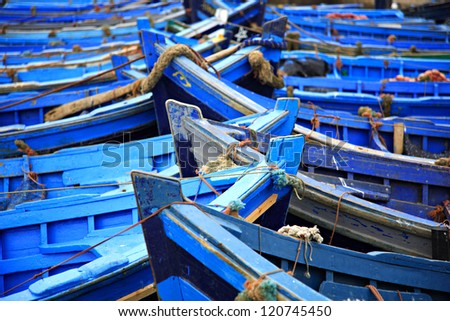 Blue fishing boats Essaouira harbor Morocco - stock photo