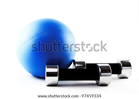 Blue fitness ball with silver hand weights in lying position - stock photo