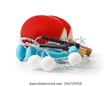 Blue fitness dumbbells, skipping rope and red table tennis rackets isolated on white background - stock photo