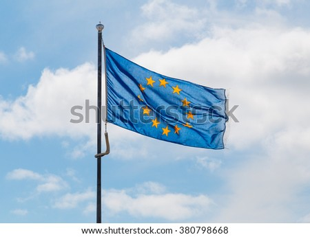 Blue flag of the European Union backlit by the sun - stock photo