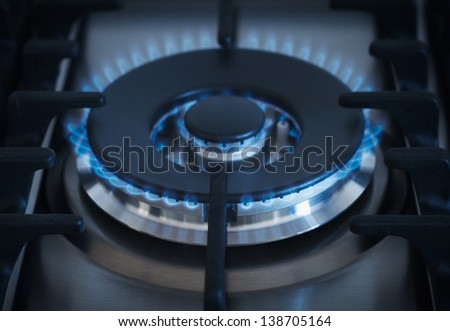 Blue flames from gas kitchen range