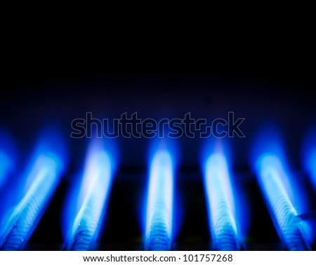 Blue flames of a gas burner inside of a boiler - stock photo