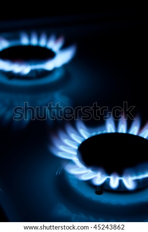 Blue flames of gas stove - stock photo