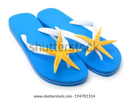 Blue flip flops with starfishes isolated on white - stock photo
