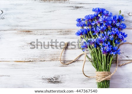 Blue Flowers Of Cornflowers Rustic Bouquet Picked In Summer Located On Wooden Background